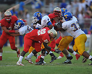 Lafayette High's Shaquille Williams (22) makes a tackle in the first quarter vs. Tupelo in Oxford, Miss. on Friday, August 17, 2012. Lafayette won 8-3.