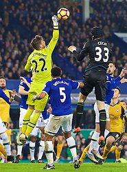 LIVERPOOL, ENGLAND - Tuesday, December 13, 2016: Everton's goalkeeper Maarten Stekelenburg challenges Arsenal's goalkeeper Petr Cech in injury time during the 2-1 FA Premier League victory at Goodison Park. (Pic by David Rawcliffe/Propaganda)