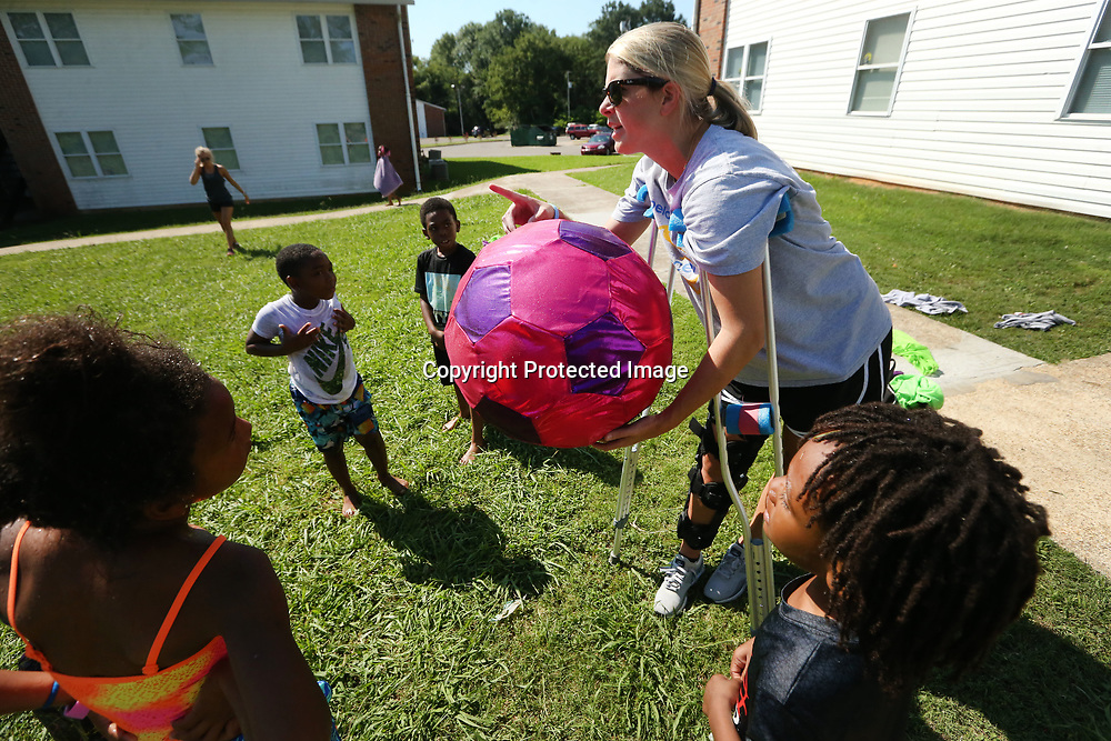 Hannah Kimbrough, Tupelo Girls Head Soccer Coach, splits kids up into teams for a scrimmage during soccer camp at Hilldale Apartments on Wednesday morning in Tupelo. Kimbrough, along with some players from her soccer team, volunteered to help teach the game to those participating.
