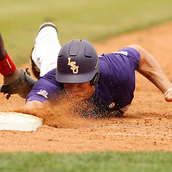 Apr 04, 2010; Baton Rouge, LA, USA; LSU Tigers Mikie Mahtook (8) beats the tag by Georgia Bulldogs first baseman Robert Shipman back to first base during a game at Alex Box Stadium. Mandatory Credit: Derick E. Hingle-US PRESSWIRE