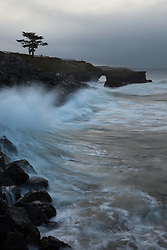 """Arch Rock, Santa Cruz 1"" - Photography of a wave splashing along the shoreline in front of Arch Rock at West Cliff, Santa Cruz."
