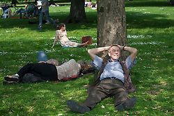© licensed to London News Pictures. London, UK 23/05/2012. People enjoying sunshine in St. James's Park today as thermometers show 27 degrees in London (23/05/12). Photo credit: Tolga Akmen/LNP