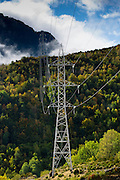 Electricity pylons cross the landscape in Valle de Tena the Pyrenees mountain range in Aragon, Northern Spain
