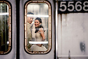 Manhattan, New York, USA, 20080605:  Travelers shift to rail as fuel cost rise.<br /> <br /> <br /> <br /> A bride and a groom riding on the A subway train on Manhattan.<br /> <br /> <br /> <br /> Photo: Orjan F. Ellingvag/ Dagens Naringsliv