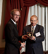 David Pidwell is presented his Konneker award by Joseph Shields, vice president for research and creative activity and dean of the Graduate College