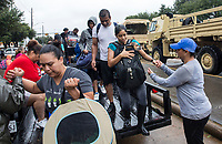 Residents flee flood waters near Barker Cypress on the west side of Houston, TX on Tuesday August 29, 2017. (Photo/Scott Dalton)