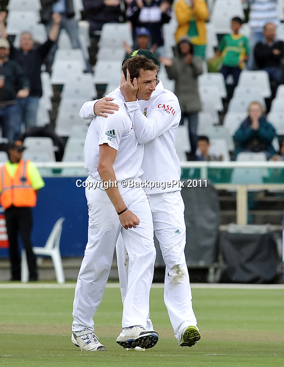 Dale Steyn of South Africa is congratulated by AB de Villiers after taking a wicket. South Africa v Australia, first test, day 1, Newlands, South Africa. 9 November 2011.<br /> <br /> &copy;Ryan Wilkisky/BackpagePix