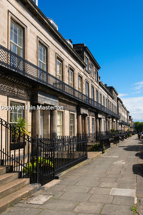 View of townhouses on historic Regent Terrace  below Calton Hill in Edinburgh, Scotland, United Kingdom