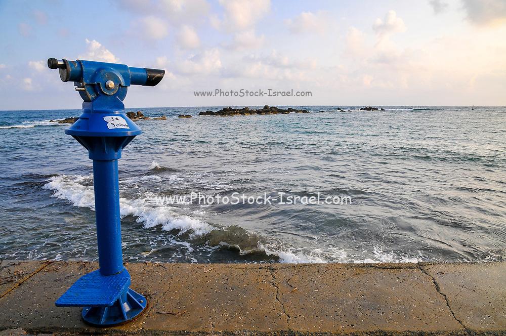 Blue telescope for looking out to sea. Photographed at Paphos, Cyprus