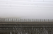 Doncaster - Monday, Feb 18 2008: Railway lines and overhead power lines in the mist and frost at Potteric Carr Nature Reserve.  (Photo by Peter Horrell / http://www.peterhorrell.com)