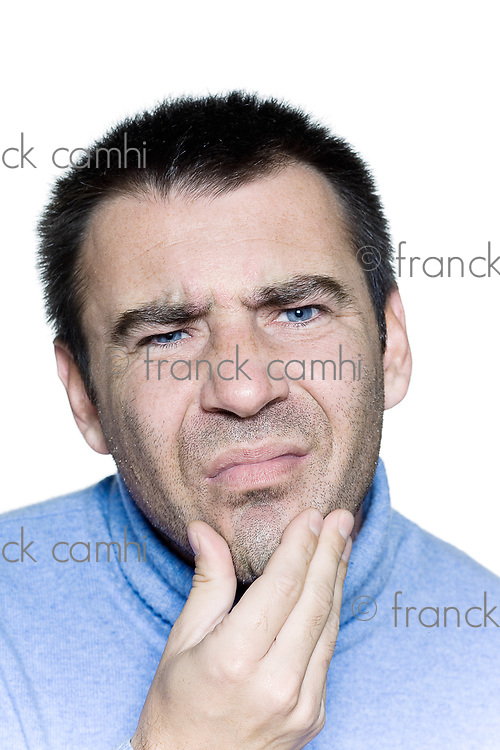 expressive portrait on isolated background of a stubble man tired hangover