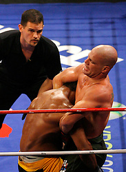 August 2, 2007; East Rutherford, NJ, USA; The Silverbacks Gerald Harris (Yellow Trunks) is caught in a guillotine choke by the Anacondas Benji Radach (Green Trunks) during their semifinal bout at the Continental Airlines Arena in East Rutherford, NJ.  Harris escaped but was knocked out moments later.