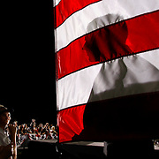Supporters of Vice Presidential candidate Joe Biden look up at a distorted shadowy figure of a Secret Service agent at a rally in New Port Richey.