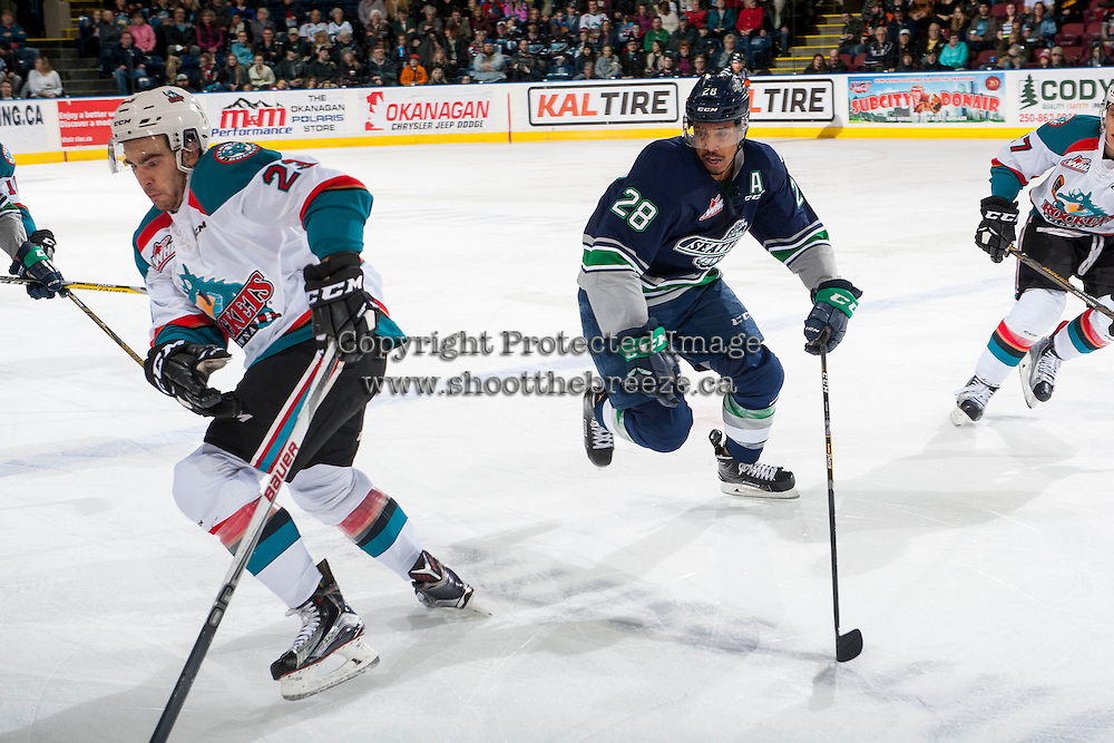 KELOWNA, CANADA - FEBRUARY 13: Keegan Kolesar #28 of the Seattle Thunderbirds back checks Reid Gardiner #23 of the Kelowna Rockets during first period on February 13, 2017 at Prospera Place in Kelowna, British Columbia, Canada.  (Photo by Marissa Baecker/Shoot the Breeze)  *** Local Caption ***