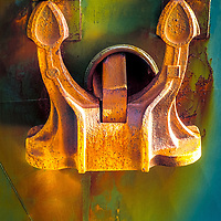 Detail of ship anchor, rust, blue hull