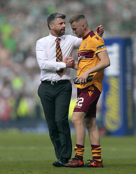 Motherwell's Stephen Robinson (left) consoles Allan Campbell after the William Hill Scottish Cup Final at Hampden Park, Glasgow.
