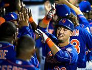 New York Mets Michael Conforto celebrates his two-run home run against the Philadelphia Phillies, Sept. 2, 2015, in New York. (AP Photo/Kathy Kmonicek)