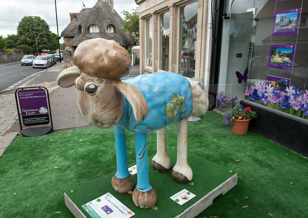 © Licensed to London News Pictures. 06/07/2015. Bristol, UK.  SHAUN THE SHEEP, 'The Tale of Peter Rabbit' designed by Beatrix Potter.  The Shaun in the City trail starts today with 70 5ft tall Shaun the Sheep sculptures originally devised by Aardman Animations with these sculptures decorated by various artists.  The Shaun trail happened in London in the spring, and the Bristol Trail lasts till 31 August.  At the end of September all 120 Shaun sculptures will be viewable together in Covent Garden.  All sculptures will then go to auction on 8th October, with proceeds from the Bristol sculptures benefitting The Grand Appeal which funds pioneering medical equipment, facilities, and comforts for patients at Bristol Children's Hospital. Proceeds from the London sculptures will benefit Wallace & Gromit's Children's Charity supporting children's hospitals and hospices throughout the UK. Photo credit : Simon Chapman/LNP