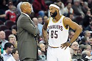 March 8, 2011; Cleveland, OH, USA; Cleveland Cavaliers head coach Byron Scott talks with Cleveland Cavaliers point guard Baron Davis (85) during the fourth quarter against the Golden State Warriors at Quicken Loans Arena. The Warriors beat the Cavaliers 95-85. Mandatory Credit: Jason Miller-US PRESSWIRE