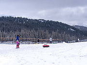 Snow tubing at Keystone Ski Resort, Keystone, Colorado, USA.