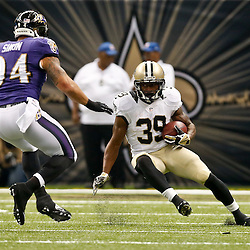 Aug 28, 2014; New Orleans, LA, USA; New Orleans Saints running back Travaris Cadet (39) is pursued by Baltimore Ravens linebacker John Simon (94) during the first half of a preseason game at Mercedes-Benz Superdome. Mandatory Credit: Derick E. Hingle-USA TODAY Sports