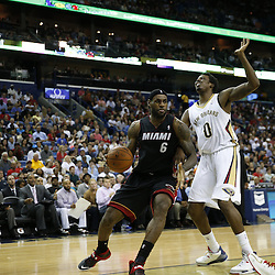 Mar 22, 2014; New Orleans, LA, USA; Miami Heat forward LeBron James (6) is defended by New Orleans Pelicans forward Al-Farouq Aminu (0) during the second half of a game at the Smoothie King Center. The Pelicans defeated the Heat 105-95. Mandatory Credit: Derick E. Hingle-USA TODAY Sports
