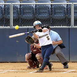 Staff photos by Tom Kelly IV<br /> Neumann's Allie White (5) gets a hold of one during her first at bat against Gwynedd Mercy, but it was foul as it soured over the outfield fence.