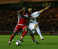 Photo: Jed Wee.<br /> Middlesbrough v FC Basle. UEFA Cup. Quarter-Final. 06/04/2006.<br /> <br /> Middlesbrough's Yakubu (L) has a penalty claim after he is brought down by Basle's Daniel Majstorovic.