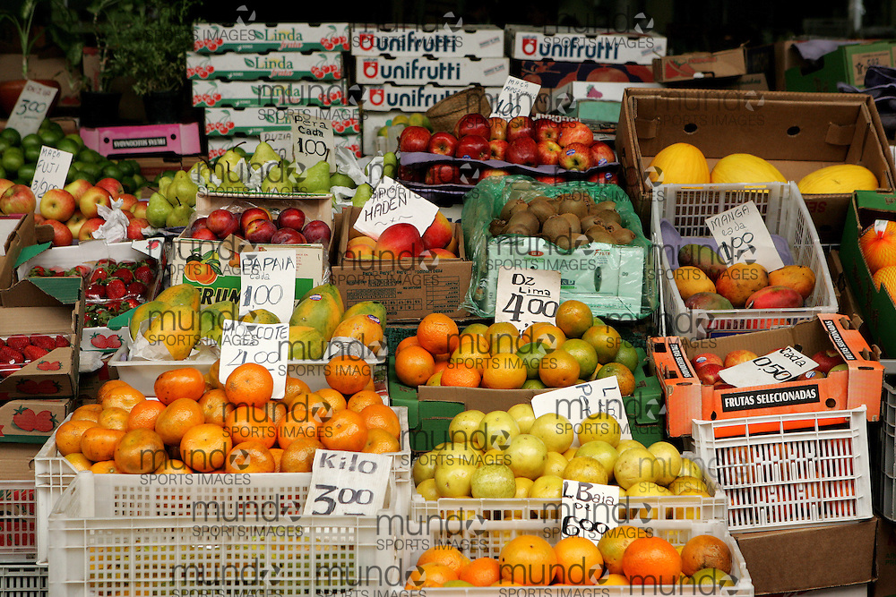 Citrus fruits such as oranges, limes, lemons, and apples for sale in the Mercado Municipal fruit and vegetable market in São Paulo, Brazil.