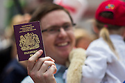 Deutschland | Frankfurt | 25.06.2015 : Queen Elisabeth II is visiting Frankfurt during her trip to Germany<br /> <br /> here: A man is proudly showing his British Passport<br /> <br /> 20150625<br /> Sascha Rheker