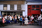 HAVANA, CUBA: People stand in line to pick up their government ration of bread at a government bakery in the central section of Havana, Cuba. Many staples, like bread, rice and meat are still rationed in Cuba. Cubans make up for the lack of government rations by shopping in private farmers? markets and government run dollar stores.  Photo by Jack Kurtz