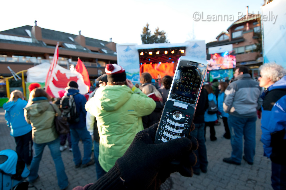 Whistler village is filled with fans cheering for the Canadian Hockey team during the 2010 Olympic Winter Games in Whistler, BC Canada