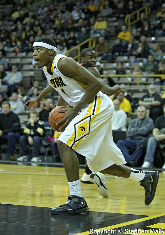 December 04 2010: Iowa Hawkeyes forward Melsahn Basabe (1) drives to the basket during the first half of their NCAA basketball game at Carver-Hawkeye Arena in Iowa City, Iowa on December 4, 2010. Iowa won 70-53.
