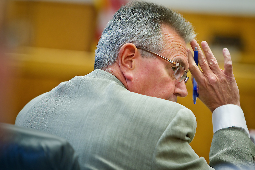 Jim Brannon looks back at the crowd in attendance for a hearing Tuesday at the Kootenai County Courthouse where his request for summary judgment in his election challenge case was denied. The case will proceed to it's scheduled four-day trial beginning Sept. 13.