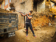 01 MARCH 2017 - KHOKANA, NEPAL: A worker removes ruble from a home destroyed in the 2015 Nepal earthquake. Recovery seems to have barely begun nearly two years after the earthquake of 25 April 2015 that devastated Nepal. In some villages in the Kathmandu valley workers are working by hand to remove ruble and dig out destroyed buildings. About 9,000 people were killed and another 22,000 injured by the earthquake. The epicenter of the earthquake was east of the Gorka district.     PHOTO BY JACK KURTZ