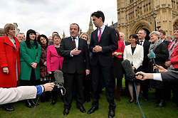 Newly Elected MP for Wythenshawe and Sale East Mike Kane MP (left) and Labour leader Ed Miliband (right) speak to press on College Green next to The House of Commons, London, UK.<br /> Monday, 24th February 2014. Picture by Ben Stevens / i-Images