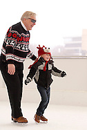 Mark Gapinski of Miamisburg skates with his godson Parker Crow,4 of West Milton during a session with mascot Parker the Penguin on the ice at the RiverScape MetroPark in downtown Dayton, Sunday, January 22, 2012.  This is Crow's second visit, and Gapinski says, 'he loves skating with Parker [the Penquin.']