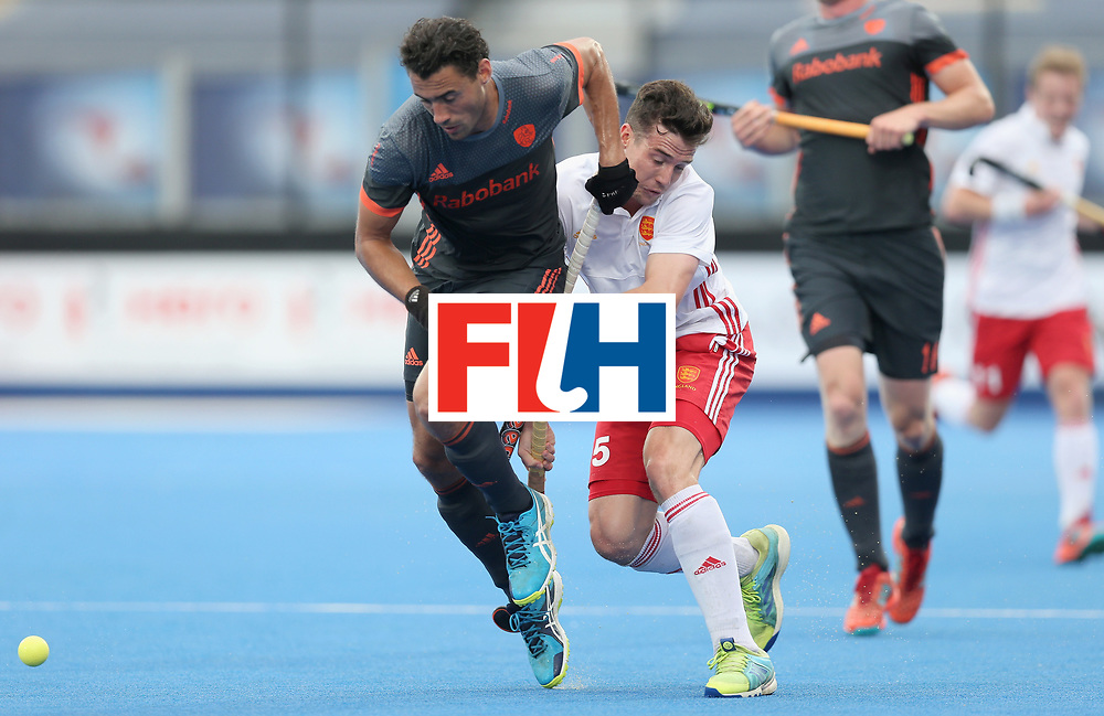LONDON, ENGLAND - JUNE 24:Glenn Schuurman of the Netherlands and Phil Roper of England battle for possession during the semi-final match between England and the Netherlands on day eight of the Hero Hockey World League Semi-Final at Lee Valley Hockey and Tennis Centre on June 24, 2017 in London, England.  (Photo by Alex Morton/Getty Images)