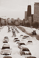 Stranded cars block the northbound lanes of Lake Shore Drive Wednesday evening after a blizzard hit Chicago late Tuesday afternoon. More than twenty inches of snow combined fell in Chicago with 50-60 mph wind gusts in a blizzard that lasted from 3pm Tuesday to approximately noon Wednesday.  Chicago Public Schools and most businesses were closed.
