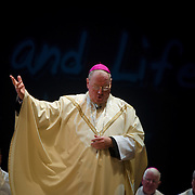 Archbishop Timothy Dolan celebrates Mass at Palacio des Desportes (the English Speaking Stadium)