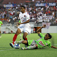 Unidentified Puerto Rico United player (4)tackles Orlando City Lions Forward Maxwell Griffin (11) during a United Soccer League Pro soccer match between Puerto Rico United and the Orlando City Lions at the Florida Citrus Bowl on April 22, 2011 in Orlando, Florida.  (AP Photo/Alex Menendez)