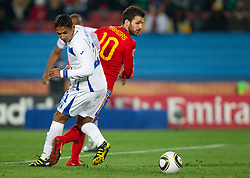Emilio Izaguirre of Honduras vs Cesc Fabregas of Spain during the 2010 FIFA World Cup South Africa Group H Second Round match between Spain and Honduras on June 21, 2010 at Ellis Park Stadium, Johannesburg, South Africa.  Spain defeated Honduras 2-0. (Photo by Vid Ponikvar / Sportida)