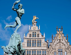 Fountain and historic buildings in Grote Markt square in Antwerp Belgium