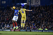 Bristol Rovers Defender, Tom Lockyer (4) beats Portsmouth Forward, Omar Bogle (22) to the ball during the EFL Sky Bet League 1 match between Portsmouth and Bristol Rovers at Fratton Park, Portsmouth, England on 19 February 2019.