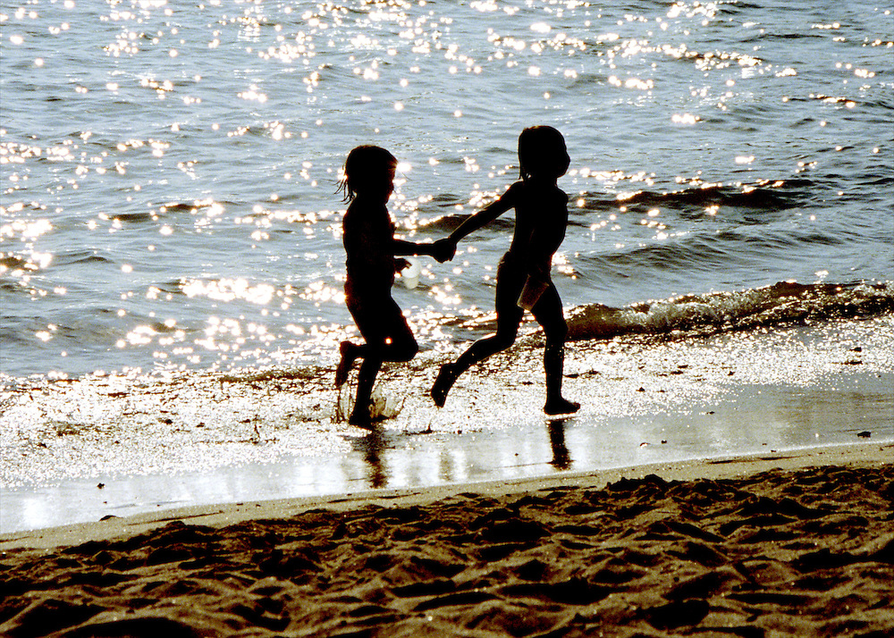 Children running on the beach, Mexico