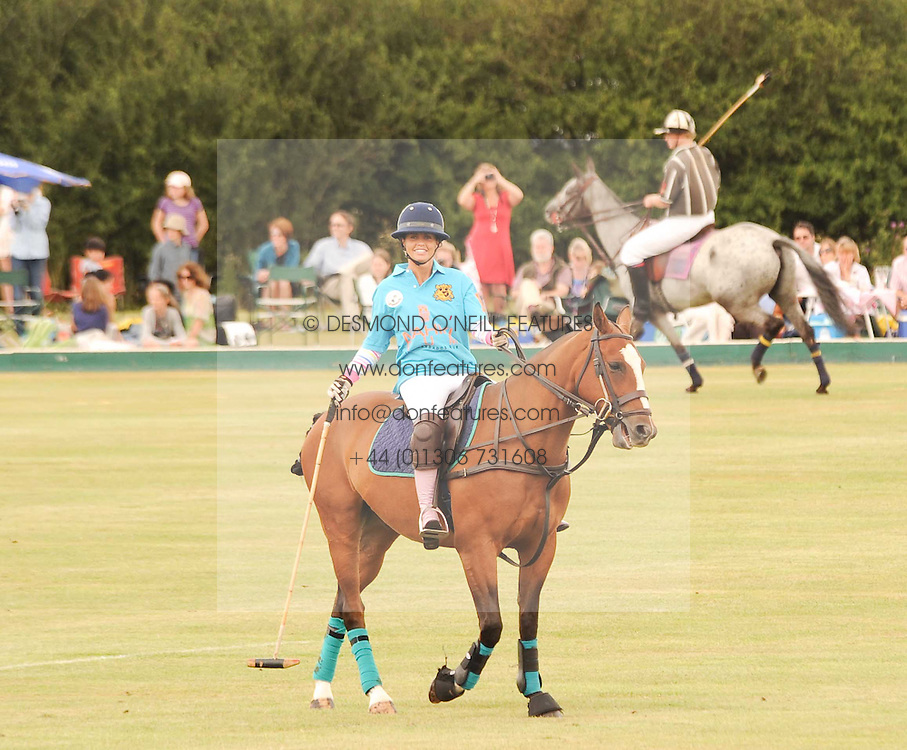 Asprey World Class Cup polo held at Hurtwood Park Polo Club, Ewhurst, Surrey on 17th July 2010.<br /> Picture shows:- KATIE PRICE playing polo