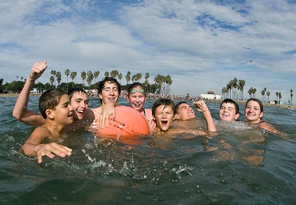 Kids celebrate reaching the marker in  the chilly Pacific Ocean during the 58th annual Polar Bear Swim at Cabrillo Beach to welcome in the New Year, Jan. 1, 2010 in San Pedro, Calif. Photo by Patrick T. Fallon