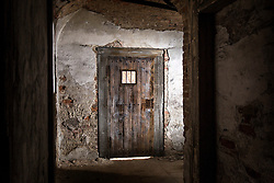 © Licensed to London News Pictures. 23/06/2015. Leeds, UK. Rarely seen hidden Tudor tunnels & cellars of Temple Newsam house in Yorkshire. Picture shows a cell that was built by production crew when a recent episode of Jonathan Strange was filmed in the cellars. Temple Newsam is famous as the birth place of Lord Darnley, notorious husband of Mary Queen of Scots. The Tudor-Jacobean mansion is set in 1,500 acres with grounds landscaped by Capability Brown. Photo credit : Andrew McCaren/LNP