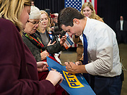 08 DECEMBER 2019 - CORALVILLE, IOWA: Mayor PETE BUTTIGIEG autographs yard signs after speaking at a campaign event in Coralville, Iowa. Buttigieg, the mayor of South Bend, Indiana, is running to be the Democratic nominee for President in the 2020 election. Iowa traditionally holds the first presidential selection event of the 2020 election cycle. The Iowa Caucuses are on Feb. 3, 2020.   PHOTO BY JACK KURTZ