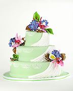 Pale Green Wedding Cake with pink and purple marzipan flowers